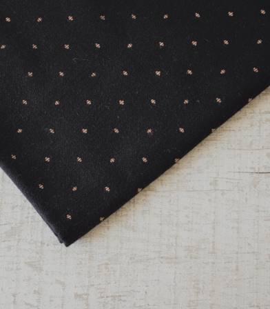 Tissu flanelle noire pois beiges